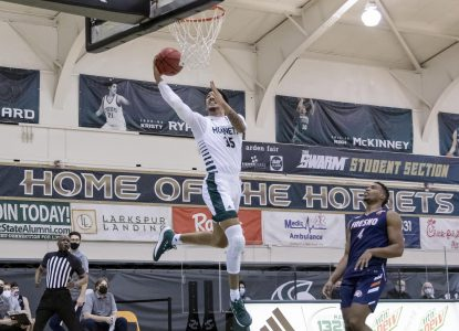 Sacramento State's Christian Terrell (35) makes a fastbreak layup past Fresno Pacific