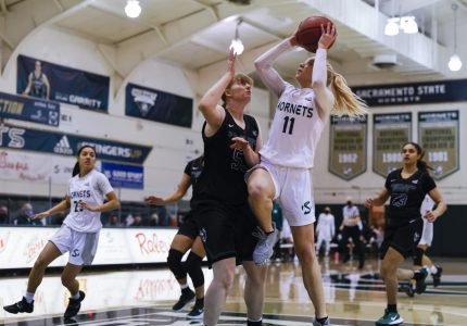 Sacramento State's Summer Menke (11) goes up strong for a layup against Portland State's Desirae Hansen (53) during the first quarter in the conference game at the Nest at Sac State in Sacramento, California, Saturday, Jan. 9, 2021. Menke had a double-double with 18 points and 11 rebounds.