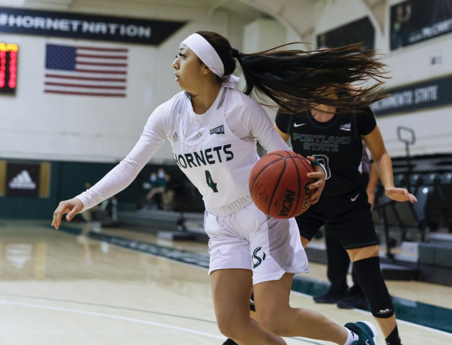 Sacramento State's Jazmin Carrasco (4) dribbles past Portland State's Kylie Jimenez (3) during the first quarter in the conference game at the Nest at Sac State in Sacramento, California, Saturday, Jan. 9, 2021. Carrasco had five points.