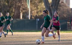 Senior forward Alyssa Baena dribbles the ball down the pitch during practice Saturday, Feb. 5, 2021 at the Sacramento State Soccer field. As a senior, Baena said she is excited to get back on the pitch after wondering if she would ever get to play soccer in college again.