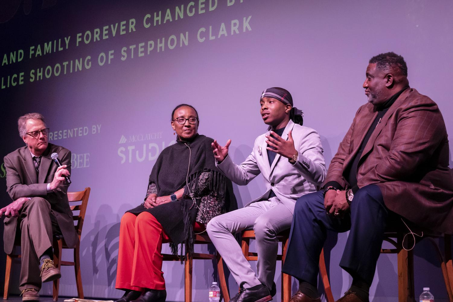 """(left to right) Sam Stanton, Sacramento Bee reporter; Jackie Rose, Rose Family Creative Empowerment; Stevante Clark, Stephon Clark's brother; and Dr. Tecoy Porter, pastor at Genesis Church and the president of the National Action Network for the Sacramento Chapter; give a Q&A after the second screening of """"'S.A.C.': A City and Family Forever Changed by the Police Shooting of Stephon Clark"""" at The Sofia Tsakopoulos Center for the Arts in Sacramento, California, Thursday, Dec. 12, 2019. Porter's church resides roughly 100 yards away from where Stephon Clark was shot and killed by police in 2018. (Sara Nevis for Sacramento City College Express)"""