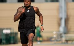 "Sacramento State football and track and field athlete Elijah Dotson runs at a track and field practice at Hornet Stadium on February 13, 2021. ""I just want to be that guy, and me working everyday is the best way for me to do it,"" Dotson said."