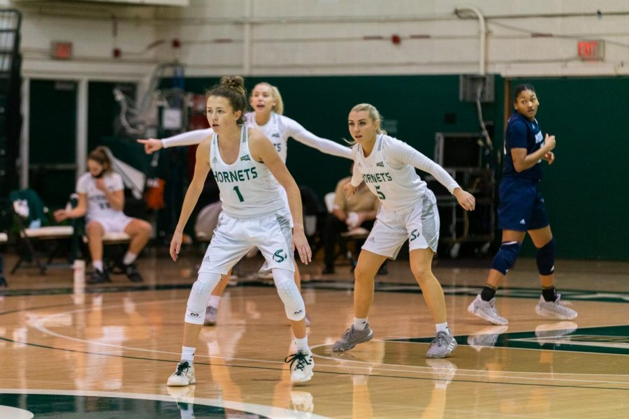 Milee Enger, Summer Menke, and Brooke Panfili square up to Nevada Wolfpack during an at-home season-opener game on Saturday, Dec. 12, 2020. The Hornets have struggled with injuries and roster continuity all season.