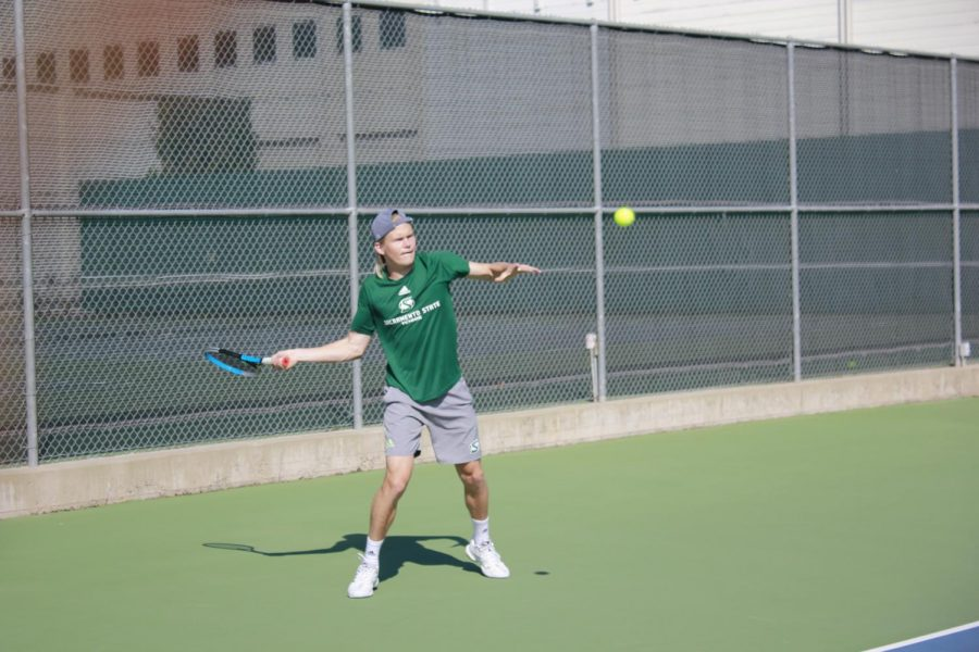 Rudolfs Aksenoks returning a volley in his singles mathcup at the campus tennis courts Friday, Feb.12. The Hornets fell to the Mustangs 4-0.