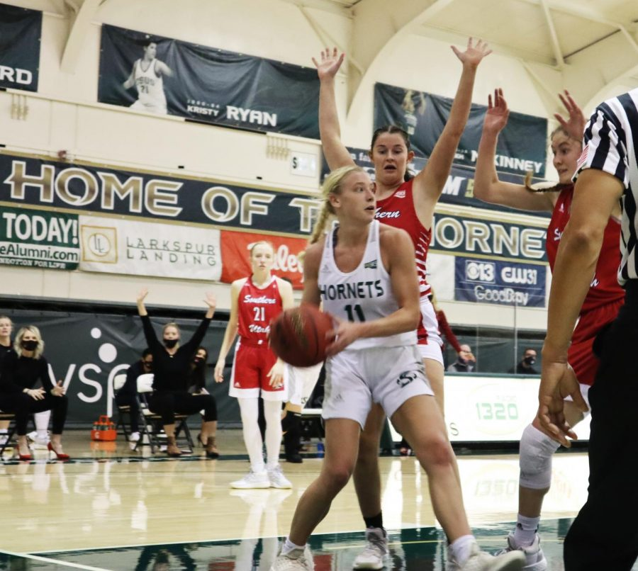 Sacramento States junior guard Summer Menke looks to pass the ball while getting double teamed on the baseline in a game at the Nest against Southern Utah on Thursday, Feb. 18, 2021. Menke had a double-double with 22 points and 12 rebounds.