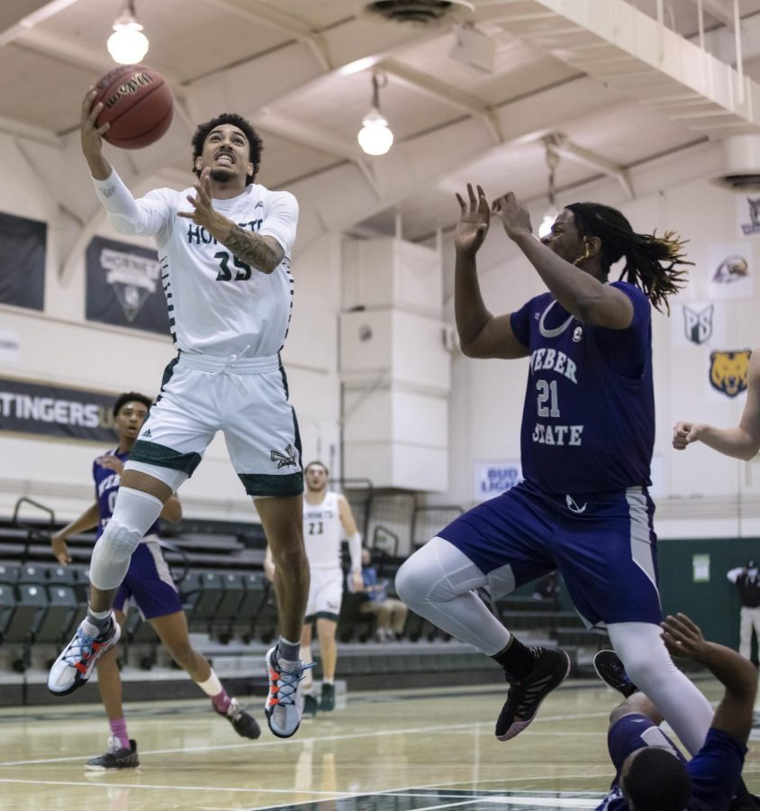 : Sacramento State senior guard Christian Terrell (35) attempts a layup past Weber State Wildcats center Dontay Bassett (21) during the second half during the conference game at the Nest at Sac State Thursday, Feb. 25, 2021. Terrell had 10 points in the game.