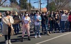 Students, parents, and alumni of St. Francis High School gather in protest on Wednesday Feb 24, 2021 against the school's retention of a student who recently shared a photo of herself wearing blackface on Snapchat. As of Wednesday, the student is no longer attending the all-women's Catholic high school.