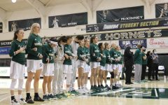 Sac State women's basketball team  lined up together, interlocking arms during the national anthem on Jan. 28, 2021. The Hornets are 1-13 overall and 1-9 in the Big Sky conference.