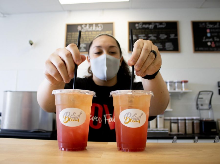 Blend owner Jennifer Duffey makes two drinks for customers on Saturday, Feb. 13, 2021. The menu includes items such as coffee, tea, juice and smoothies.