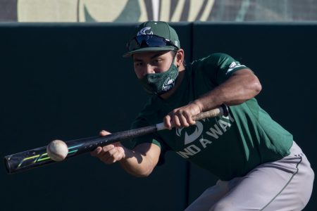 Sacramento State senior infielder Keith Torres bunts the ball while running drills during baseball practice at the John Smith Field at Sac State in Sacramento, California, Friday, Feb. 5, 2021. During last season, Torres had a batting average of .294 in the 16 games played.