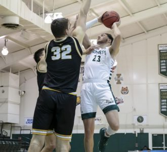 Sacramento State's Bryce Fowler (23) draws the foul shooting over Idaho's Chance Garvin (12) and Tanner Christensen (32) and goes on to make both free throws during the second half in the conference opener in the game against the University of Idaho at The Nest at Sac State Thursday, Dec. 3, 2020. Fowler led the team with 20 points, shooting 3-4 from deep and grabbing seven rebounds.