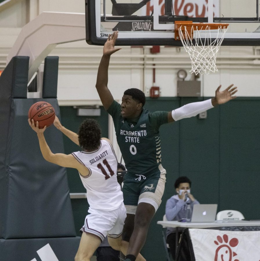 Montana Grizzlies guard Cameron Parker (11) attempts a layup over Sacramento State Hornets forward Samaad Hector (0) during the second half during the conference game at the Nest at Sac State Saturday, Jan. 23, 2021. Hector said he got sick and is awaiting COVID-19 test results.
