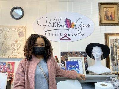 Passion Bailey, co-owner of Hidden Gems Thrift Store, poses for a photo behind the counter Saturday, Feb. 6, 2021. The store is located Florin Square, which acts as a hub for Black-owned businesses.
