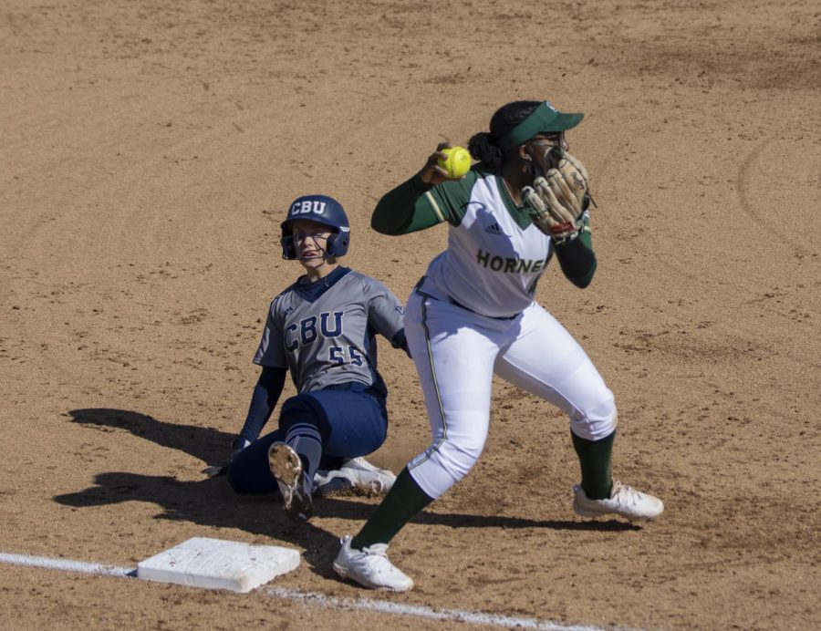Sacramento State sophomore Lewa Day (44), third base, gets California Baptist University's Maile Olsen (55) out atnd third and tries to turn a double play with a throw to first base in the top of the second inning during the NorCal Kickoff in game one of the doubleheader at Shea Stadium at Sac State, Friday, Feb. 12, 2021. Day had two at bat with one hit and one RBI.