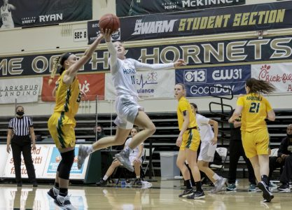 Sacramento State's Summer Menke (11) attempts a layup past University of San Francisco's Abby Rathbun (55) during the fourth quarter in the game at the Nest at Sac State Tuesday, Dec. 22, 2020.  The Hornets played Northern Arizona University Saturday and Menke had 12 points and nine rebounds but Sac State lost and moved to 1-14,1-11 Big Sky.
