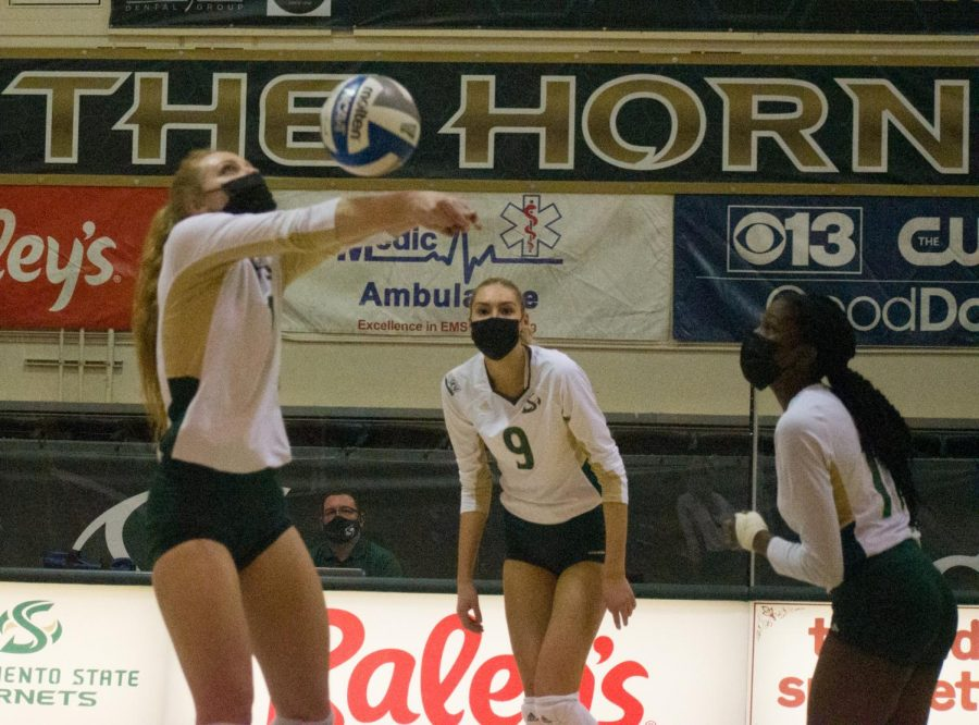 Photo Caption: McKenna Smith sets up for an attack during the home opening Sac State volleyball game Jan. 31, 2021 at the Nest. Volleyball teams, including Sac State's, are allowed to test for COVID-19 only once per week if masks are worn during practice and competition.
