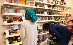 Customers browse the different types of hair and skin care products offered at The Pop Up Shop at Arden on Saturday, Feb. 27 2021. The shop is Black-owned and will offer many cultural products that range from traditional African clothing to hair and skin products to casual wear and jewelry.