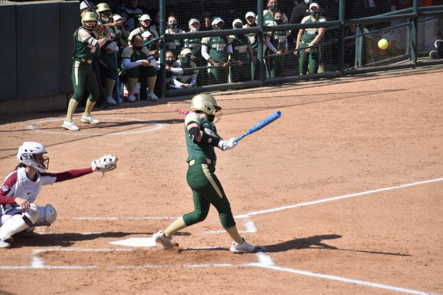 Freshman outfielder Alexis Parish hits a ball to the deep part of the outfield in the first game of the Capital Classic Tournament versus Santa Clara University at the John Smith Field at Sac State Friday, March 5, 2021. Alexis had two hits in the game, including an RBI-double.