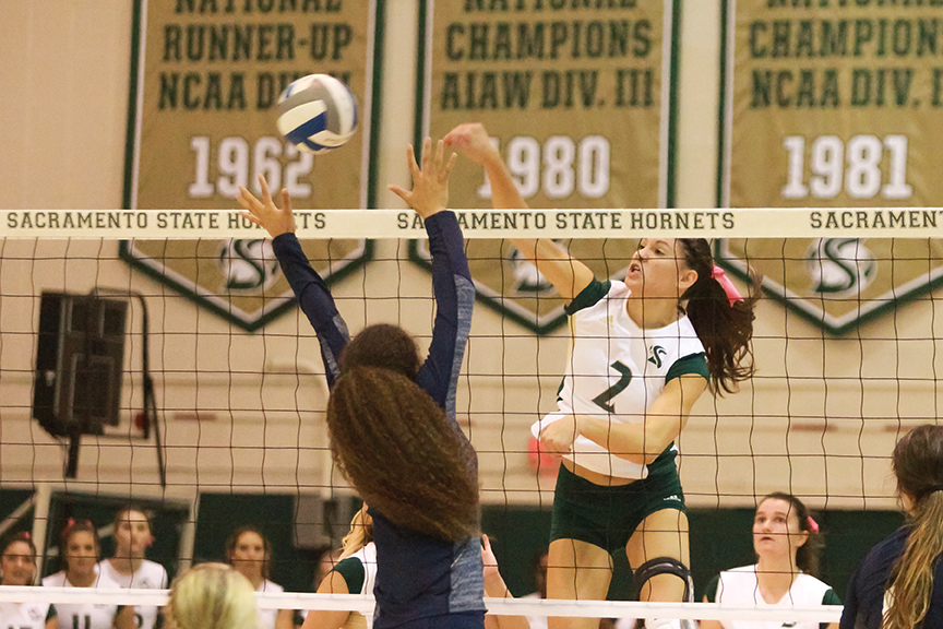 Sacramento State senior midblocker Courtney Dietrich spikes the ball passed Brittni Dorsey of Northern Arizona at the  Nest on Oct. 27, 2016. Dietrich now with the last name Hornsby married former Sac State basketball player Nick Hornsby.