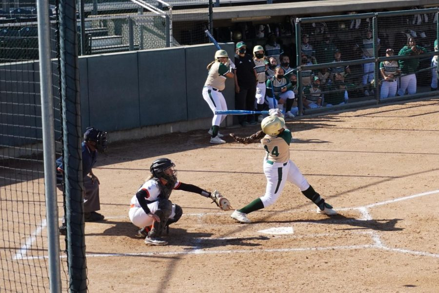Sophomore third baseman Lewa Day hits the ball in the second game against Pacific at Shea Stadium on Sunday, March 7, 2021. Day scored the winning run in the first game of the doubleheader.