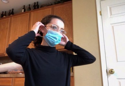 Sierra Ortiz, art major, puts on her face mask before she heads out to run errands on Wednesday, March 10, 2021. Ortiz said she makes it a priority to wear her mask before she goes out in public to keep herself safe during the COVID-19 pandemic.