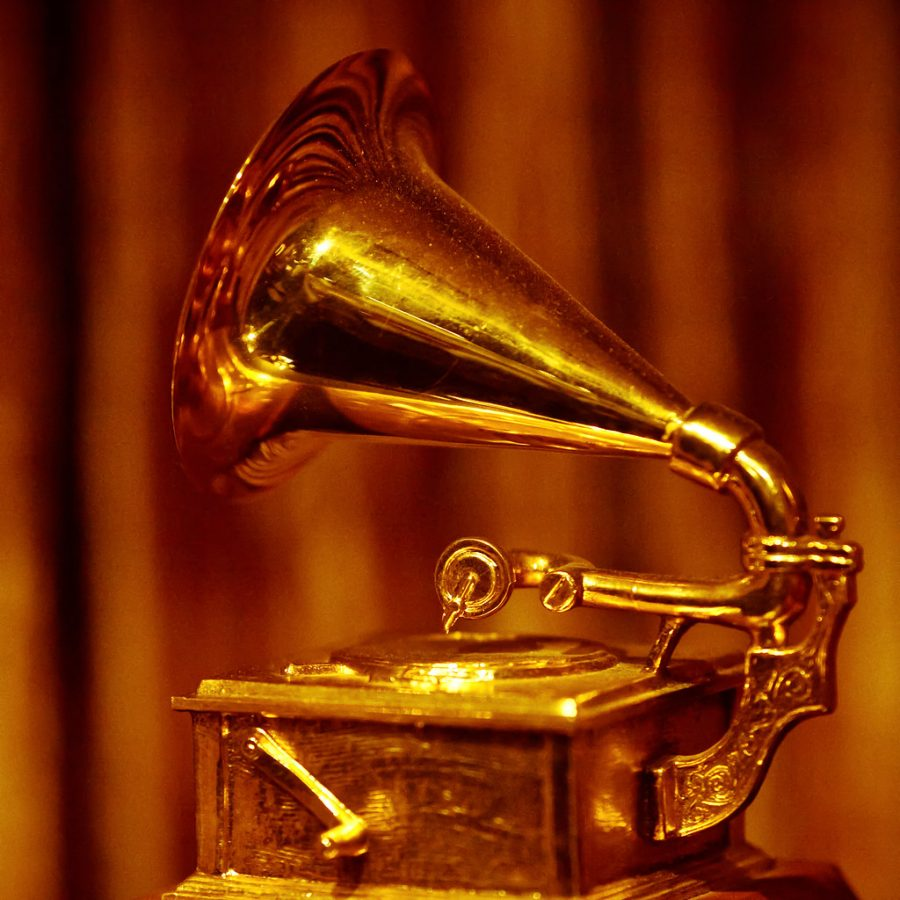 A photo of a golden Grammy Statuette, given to recipients of awards from the Recording Academy. (Photo by Thomas Hawk/CC BY-NC 2.0.)