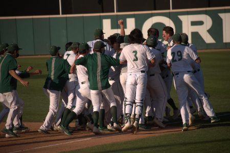 The Sacramento State baseball team rushes the field after Matt Smith's walk-off hit during the ninth inning of the home game against Stanford University at John Smith Field on Monday, March 29, 2020. The Hornets were named the 24th ranked team on Collegiate Baseball's top-25 poll on Monday, marking the first top-25 ranking in Sac State history.