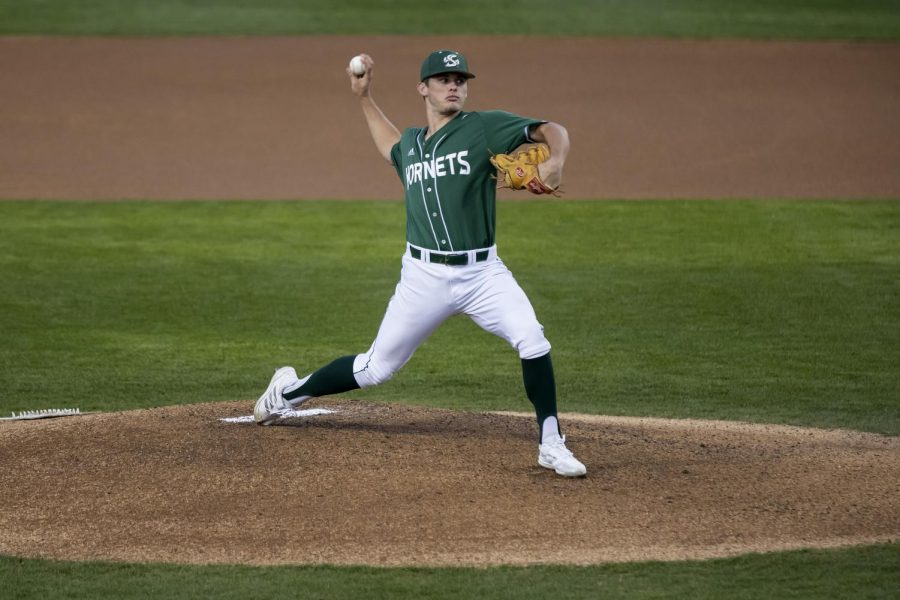 Sacramento State junior right handed pitcher Travis Adams (32) pitches the first inning with no hits in game two against Texas State University at John Smith Field at Sac State Saturday, Feb. 27, 2021. Adams pitched for five innings. Sac State won 5-4.