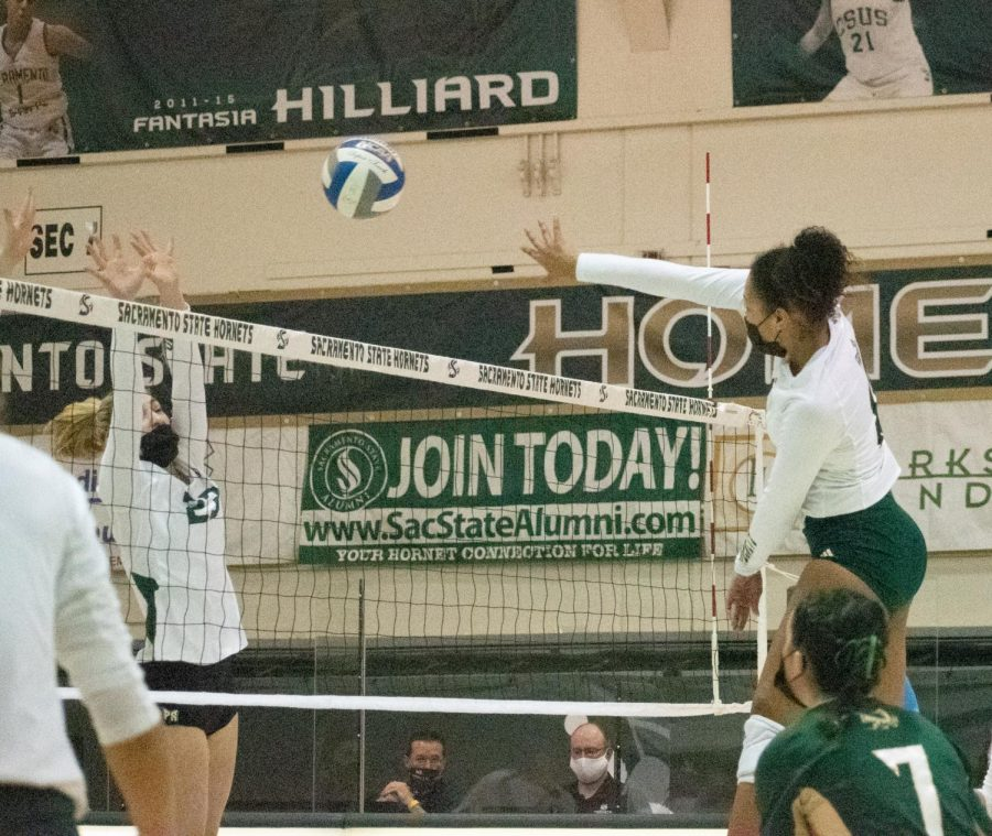 Middle blocker Kalani Hayes spikes the ball while the Portland vikings attempt to block it during the second set of Sacramento State's last game at home against Portland State University at the Nest Sunday, March 13, 2021. Hayes got 6 blocks and 7 kills in the match.