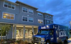 The Lark Sacramento's bus sits parked in front of the Lark on Tuesday, March 9, 2021. A female resident of the Lark Sacramento entered the apartment complex's clubhouse with a non-lethal weapon Tuesday evening, according to the Lark's management.