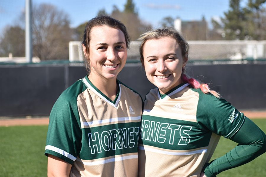 Sisters Alexis and Samantha Parish, pose for a photo together after a game at the John Smith Field at Sac State Saturday, Feb. 20, 2021. Alexis and Samantha are the first sisters to be on the Sac State  softball team together in 24 years.