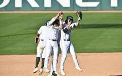 From left to right, Sac State baseball players Keith Torres, Steven Moretto, Ryan Walstad celebrate the Hornets' win against Dixie State on Friday at John Smith Field.