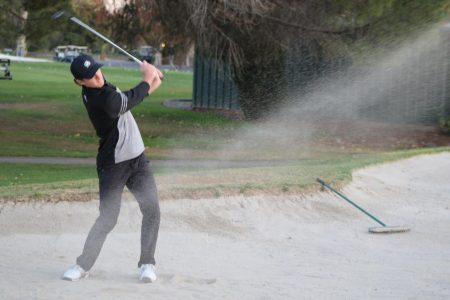 Sacramento State sophomore Ethan Davidson swings out of the sand on November 20, 2019 at Valley Hi Country Club in Elk Grove. Davidson achieved the best individual score, and the Hornets took home first place at the Big Sky Championship.