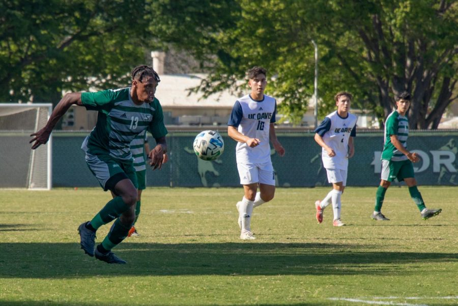 Sac State forward Titus Washington races past UC Davis' defense in an attempt to score a goal in the second period on Saturday, April 10, 2021 at Sacramento State. The Hornets went on to defeat the Aggies 2-1 at the second game of the spring exhibition.