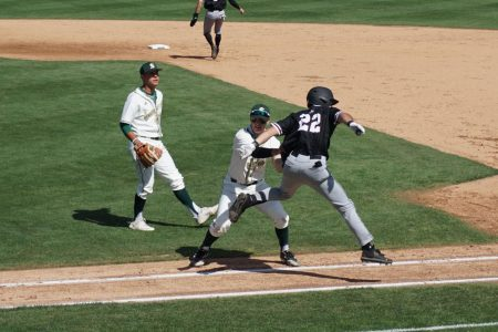 Senior infielder Ryan Walstad tags one of New Mexicos players as they leap toward first base at Sac States John Smith Field on Sunday, April 11, 2021. The Hornets beat the Aggies by a final score of 4-0.