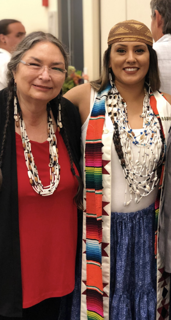 Annette Reed with Vanessa Esquivido, an alumna of Sac State, at her Ph.D. graduation at UC Davis in 2019. Esquivido is now on a tenured track Native American studies professor at California State University, Chico. Photo courtesy of Annette Reed.