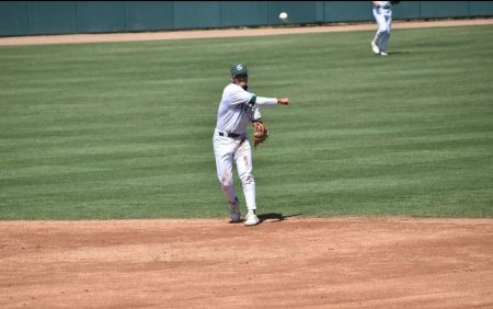 Sacramento State second baseman Jorge Bojorquez fields a roundball and throws to first in game one of Friday