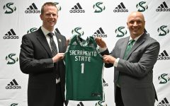 Mark Campbell and athletic director Mark Orr pose on stage Wednesday, April 21, 2021 at Sac State. Campbell was formally introduced as the next head coach for the women's basketball team. Credit: Hornet Athletics