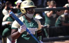 Lewa Day visualizes her hit while at bat against Santa Clara University during the Capital Classic at the Shea Stadium at Sacramento State on March 5, 2021. Lewa Day has played in all 30 of the games that the team has played so far this season.