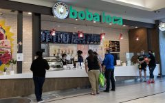 Customers order from Boba Loca inside the Arden Fair mall May 5, 2021. Workers, including assistant manager Lillian Phan, on the left behind the counter, push tea out to waiting customers.