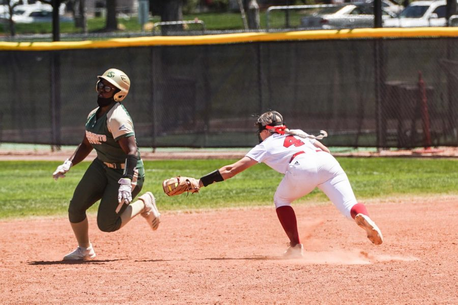 Sophomore third baseman Lewa Day secures a run for the Hornets against Southern Utah University at Kathryn Berg Field in the first game of the doubleheader Friday, May 7, 2021. Day hit four home runs during the games held Friday, setting a record for most home runs hit by one player in one calendar day in program history. Photo Credit: Joey DeGraaf and the Southern Utah University athletic department.