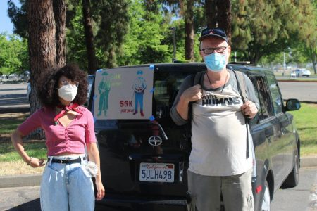 Sociology student at Chico State Melys Bonifacio-Jerez, left, stands next to protester Guillermo Marsh at the May Day Car Caravan in support of defunding university police at Sacramento State's Police Department on Saturday, May 1, 2021. CSU Students For Quality Education demanded removal of university police on the 23 CSU campuses during the Caravan.