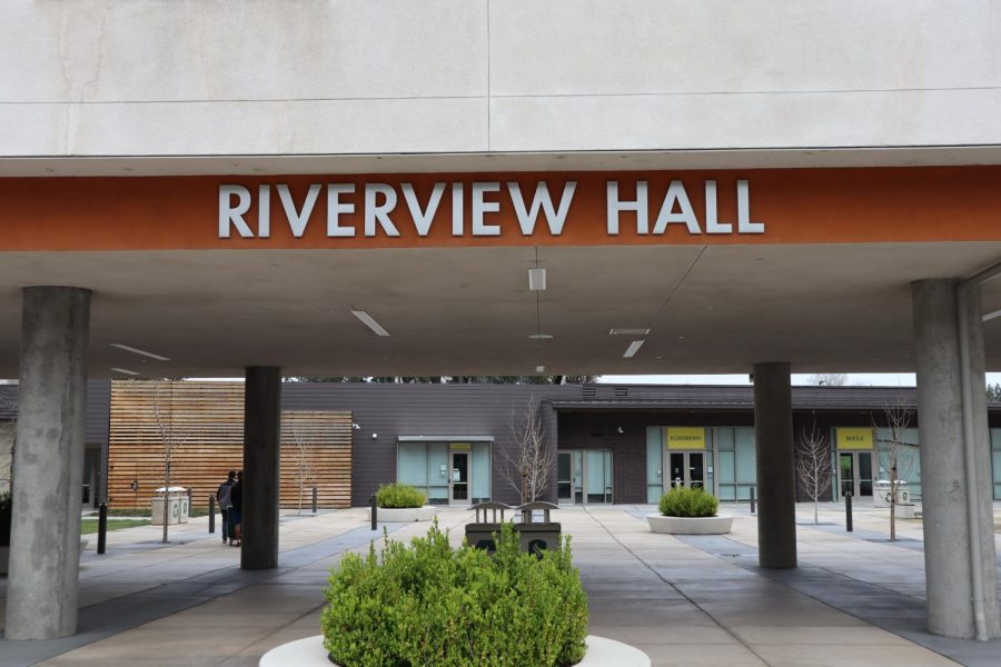 The early move-outs prompted by the coronavirus leave the Riverview Hall plaza empty aside from two people pushing a wheeled moving cart on March 18, 2020. Samuel Jones, executive director of University Housing Services, said he is working to get the Residence Halls back to full occupancy for fall 2021.