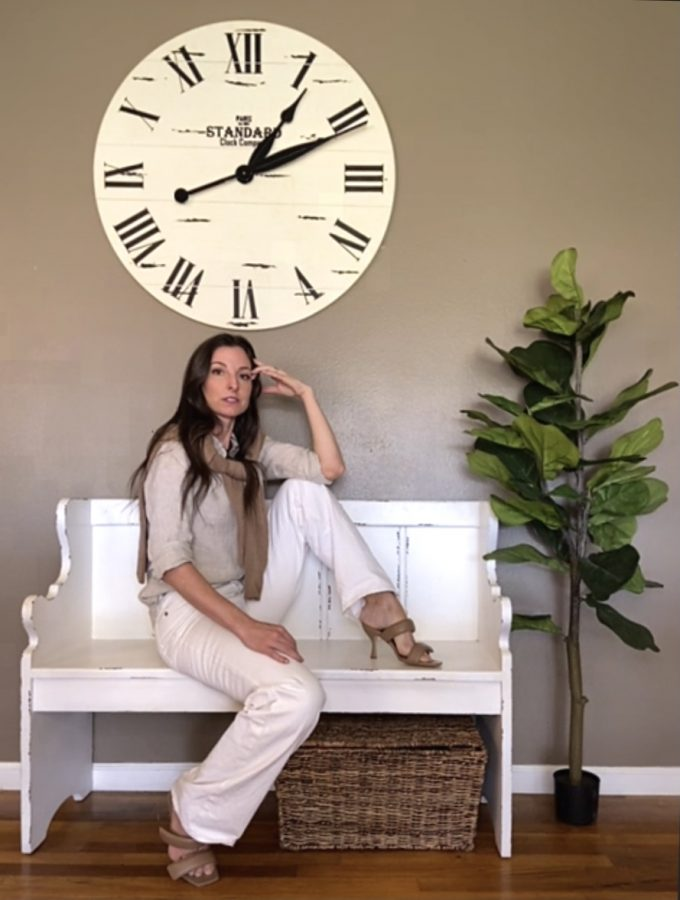 Marisa Rodgers poses in her home Friday, April 30, 2021. Rodgers says '60s and '70s fashion is on-trend this spring with wide-leg pants, retro floral prints and platform shoes to pull the look together.
