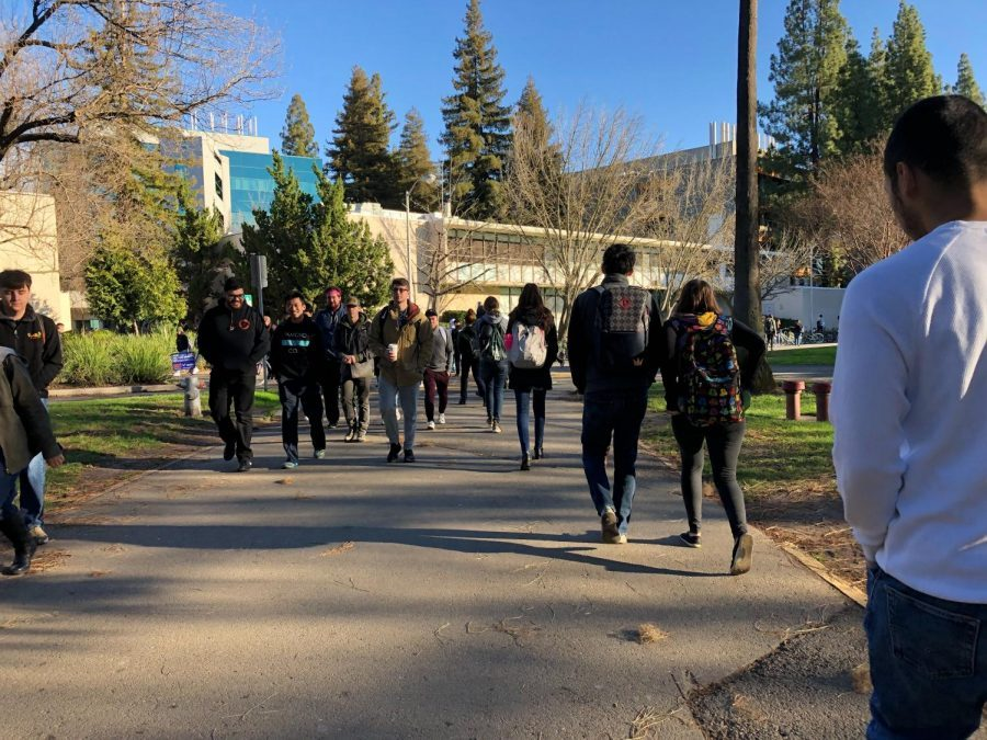 Students walk across the library quad in May 2019. Sac State students unfamiliar with campus will have an opportunity to tour and get familiarized with the university in time before returning to school in fall 2021.