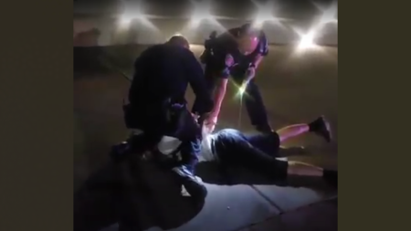 Sergeant Vincent Burton (left) of Sacramento State's Police Department kneels on the neck of a cyclist for approximately 23 seconds while handcuffing him after Corporal Doug Nguyen (right) deployed his stun gun twice into the suspect on June 4, according to anonymous sources. Photo courtesy of Francisco Munoz.