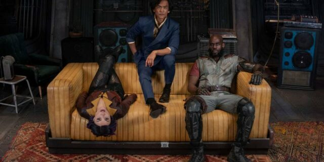 """From left to right: Daniella Pineda, John Cho and Mustafa Shakir, the main cast of 2021's """"Cowboy Bebop,"""" on set in full costume show off the distinct looks and personalities of each character. Comparisons to the original designs are inevitable, according to State Hornet staff writer Zachary Cimaglio. (Image credit: Netflix)"""