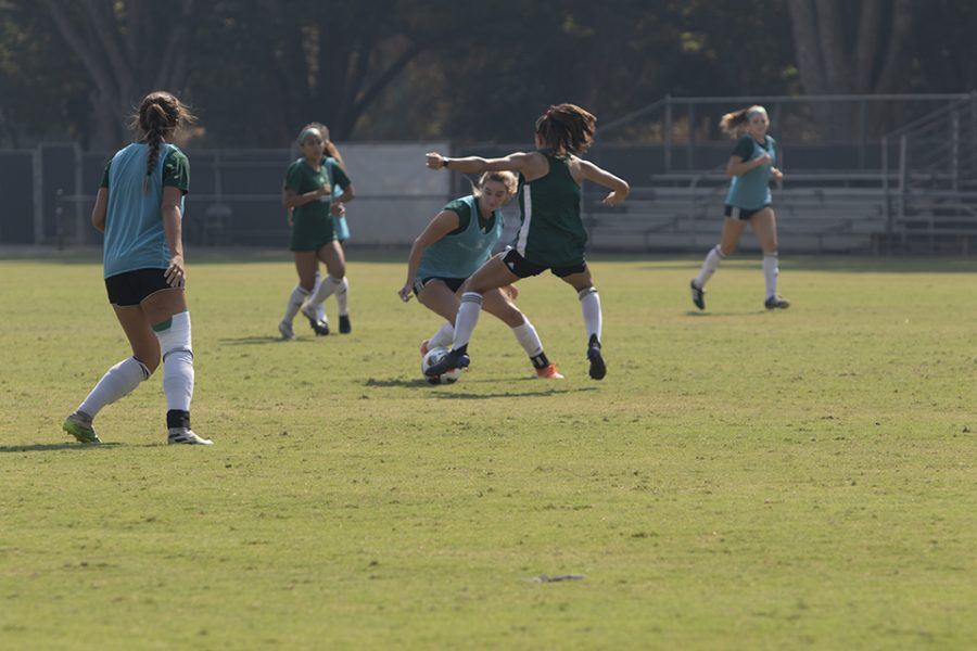 Sac State women's soccer players engage in a scrimmage with dribbling the ball through defense at practice on Friday, Sept. 24, 2021 at Hornet Soccer field. The Hornets open up conference play on the road on Sunday at1 p.m against Portland State.