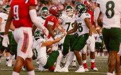 Sacramento State Tight End Marshel Martin (16), helps his quarterback Asher OHara up at end of the play. OHara connected with Martin twice to give the Hornets their only two touchdowns of the game against Dixie State University Saturday, Sept. 4, 2021.