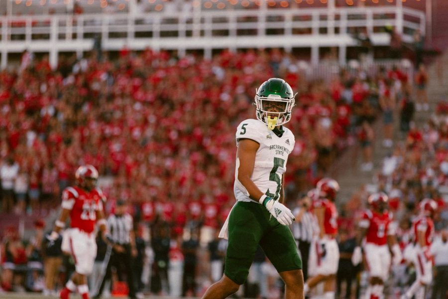 Sacramento State freshman wide receiver Devin Gandy (5) walking back to the huddle while he looks at the sidelines. The Hornets beat Dixie State University 19-7 on Saturday, Sept. 4, 2021.